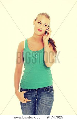 Young blonde woman talking on the phone