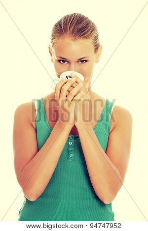 Blonde woman drinking from cup