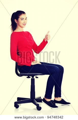 Young happy woman sitting on a chair