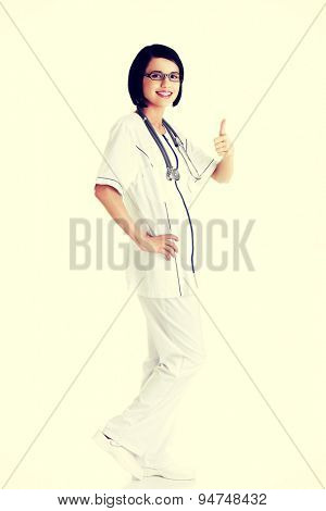 Young beautiful female doctor thumbs up