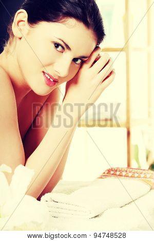 Young beautiful woman in spa
