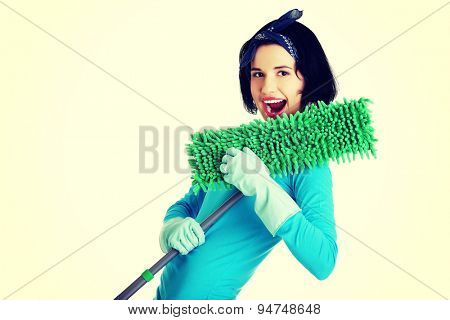 Cheerful woman with a mop