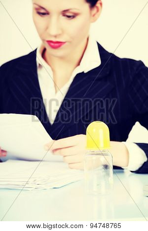 Young beautiful businesswoman reading documents