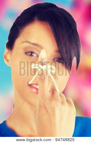 White string on woman finger
