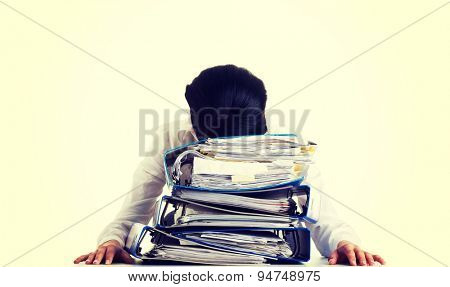 Exhausted businesswoman with a lot of documents