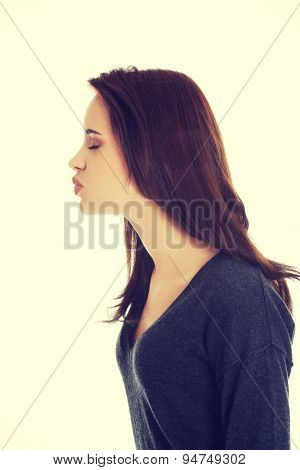 Young beautiful woman blow a kiss