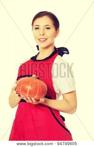 Young happy woman holding a pumpkin