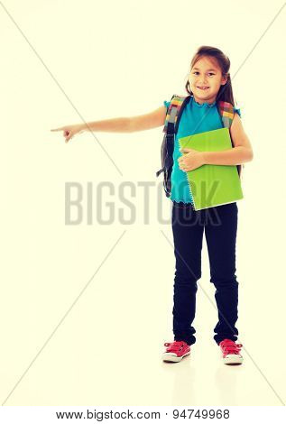 Little girl holding notebooks and backpack