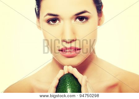 Close up on a woman holding avocado