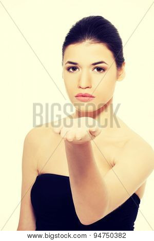 Young woman gesturing by hand