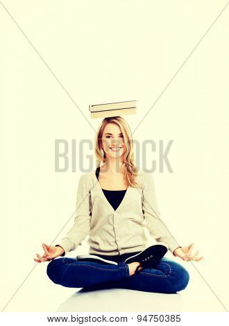 Student woman with book on head - meditating