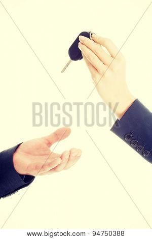 Businesswoman giving car keys to the man