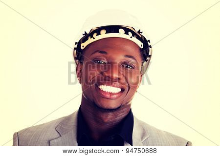 Black handsome businessman wearing helmet