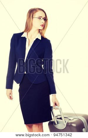 Young beautiful businesswoman holding travel bag