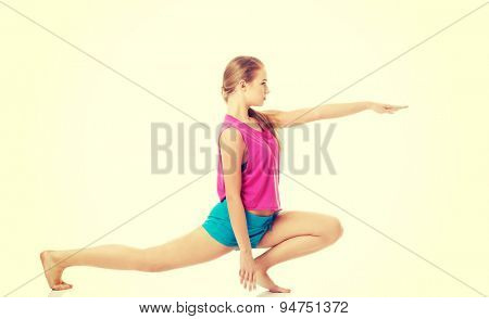 Beautiful woman stretching at home