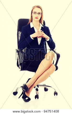 Beautiful businesswoman relaxing on a chair