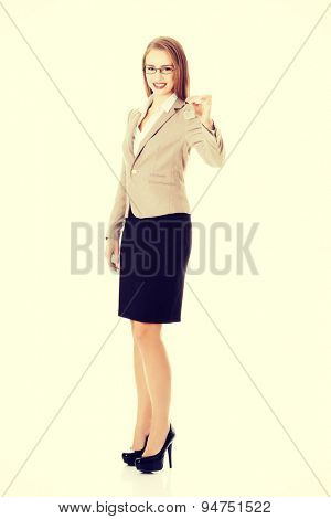 Happy woman agent holding the keys