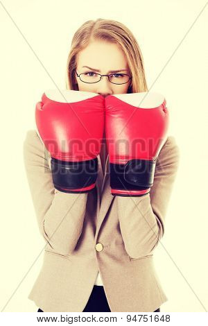 Beautiful woman wearing boxer gloves