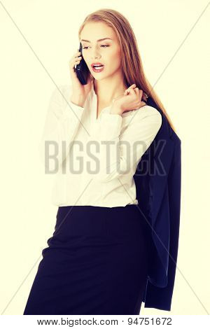 Blonde businesswoman holding her jacket