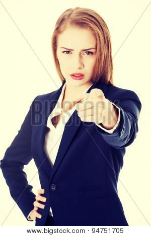 Blonde businesswoman pointing on you