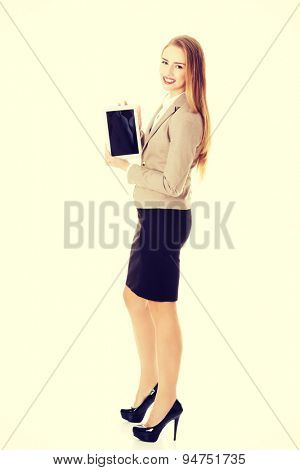 Happy businesswoman holding a tablet