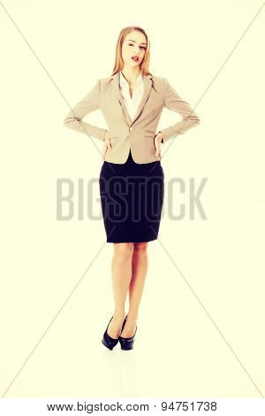 Attractive young blonde businesswoman standing
