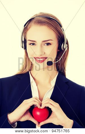Young call center woman holding heart