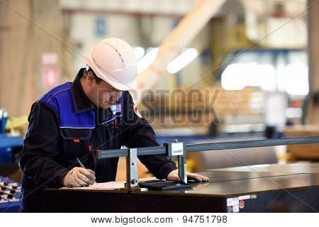 VSEVOLOZHSK, LENINGRAD OBLAST, RUSSIA - JUNE 5, 2015: Worker at work the joint enterprise Severstal-SSC-Vsevolozsk. The joint venture of Russian Severstal and Japanese Mitsui was established in 2010