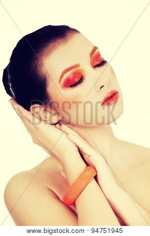 Young beautiful woman in full make up