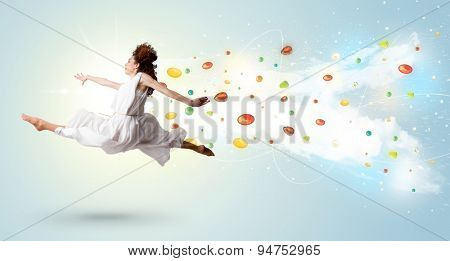 Beautiful woman jumping with colorful gems and crystals on the background concept
