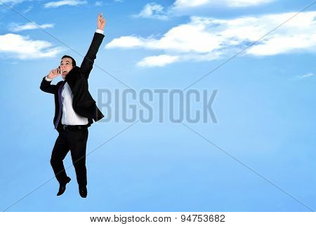 Business man happy jump talking phone