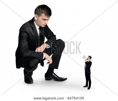 Isolated business man looking at little man