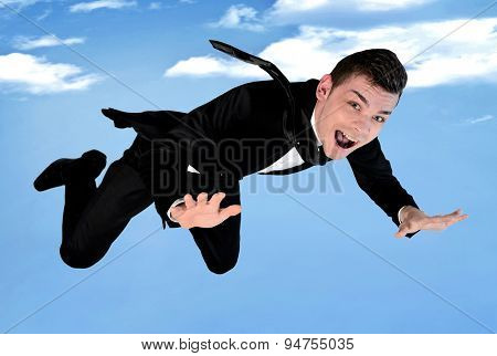 Business man fly showing ok sign