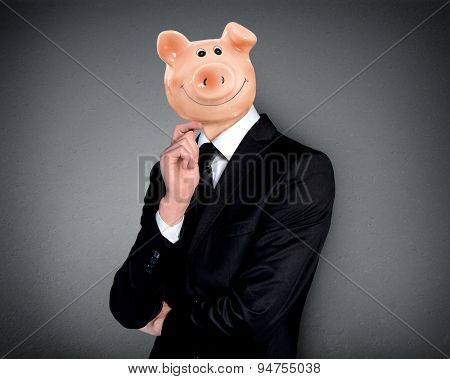 Business man with piggy bank head