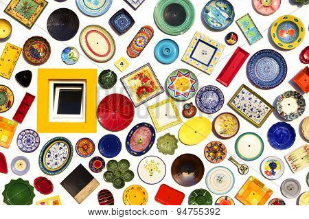 SAGRES, PORTUGAL - JUNE 07: colorful ceramic plates on the wall of the pottery store in Sagres, Portugal on June 07, 2015