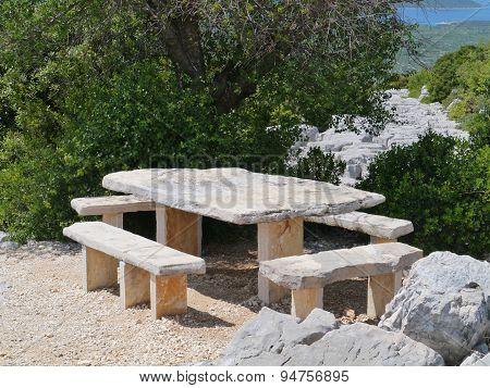 Seats under a tree on Kamenjak mountain