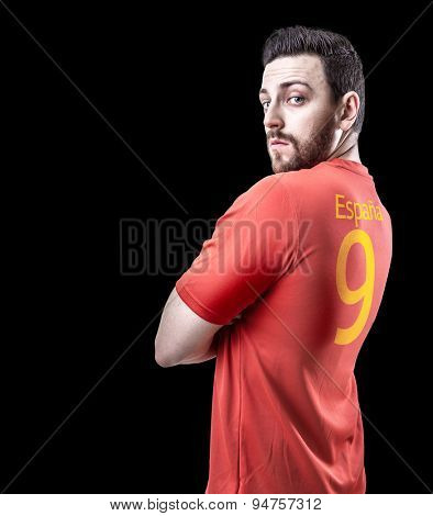 Spanish soccer player on black background