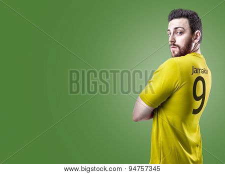 Jamaican soccer player on green background