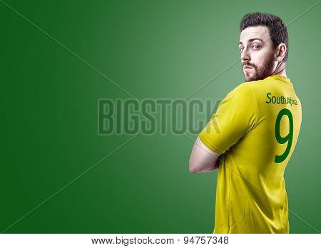 South African soccer player on green background