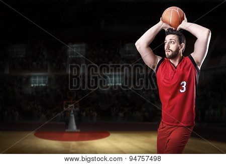 Basketball Player on a red uniform in basketball court.