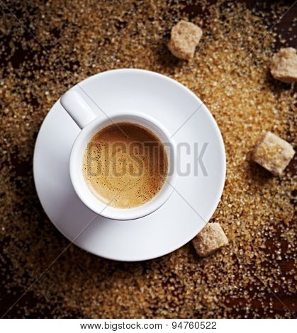 Cup of black coffee on brown sugar