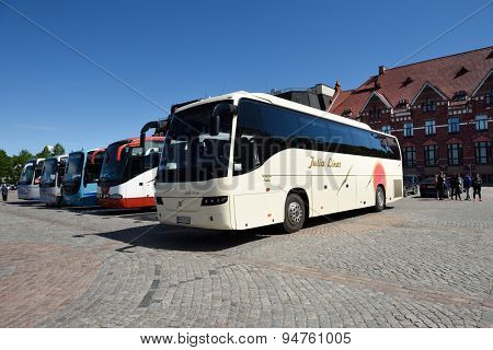 VYBORG, LENINGRAD OBLAST, RUSSIA - JUNE 6, 2015: People at the Finnish tourist buses on the market square. The city located 40 km far from the board of Finland and is very popular travel destination