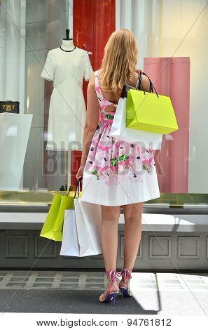 Girl with shopping bags at the sale
