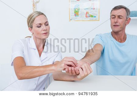 Doctor doing hand massage in medical office