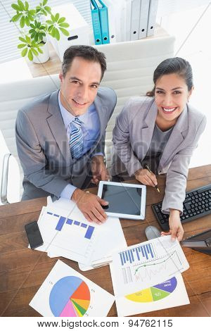 Businesswoman working with team mate in an office