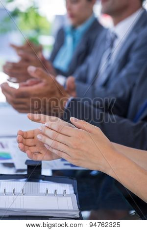 Business team clapping in meeting room