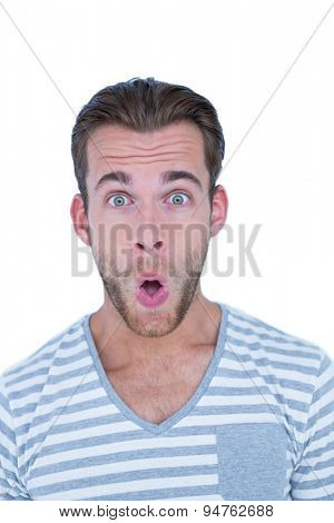 Surprised casual man looking at camera on white background