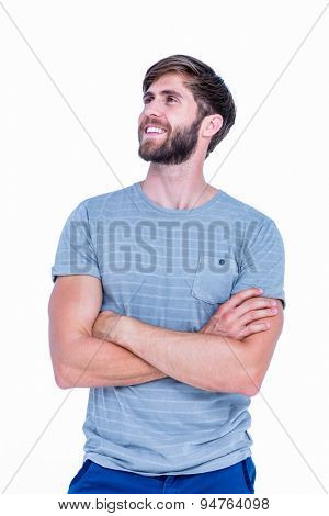 Happy handsome man with arms crossed on white background