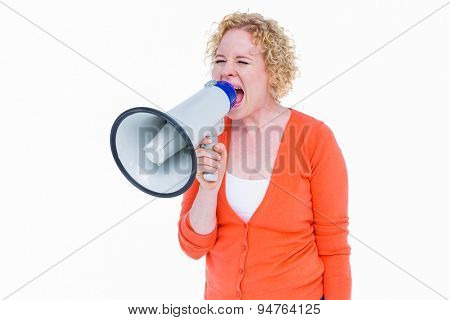 Pretty blonde speaking into megaphone on white background