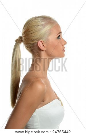 Profile portrait of beautiful teen girl isolated over white background